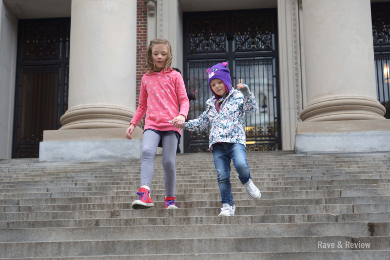 Girls skipping down Harvard steps