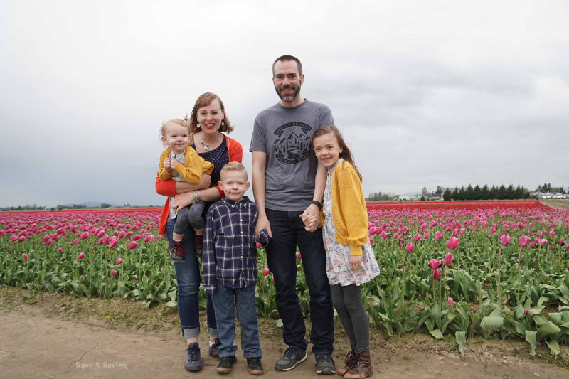 Family standing in tulips