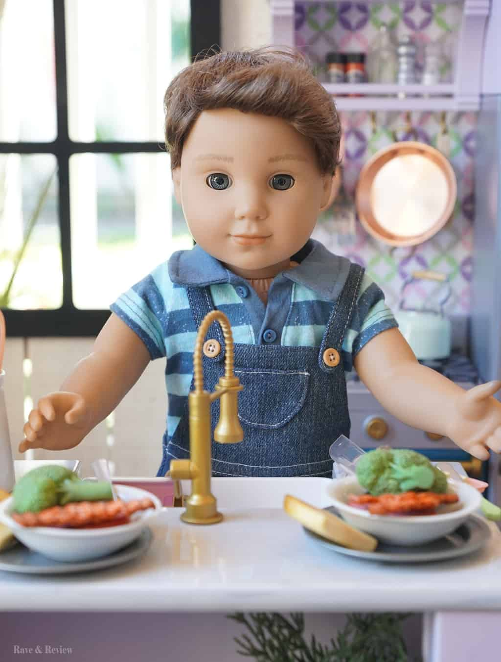 American Girl boy doll in kitchen