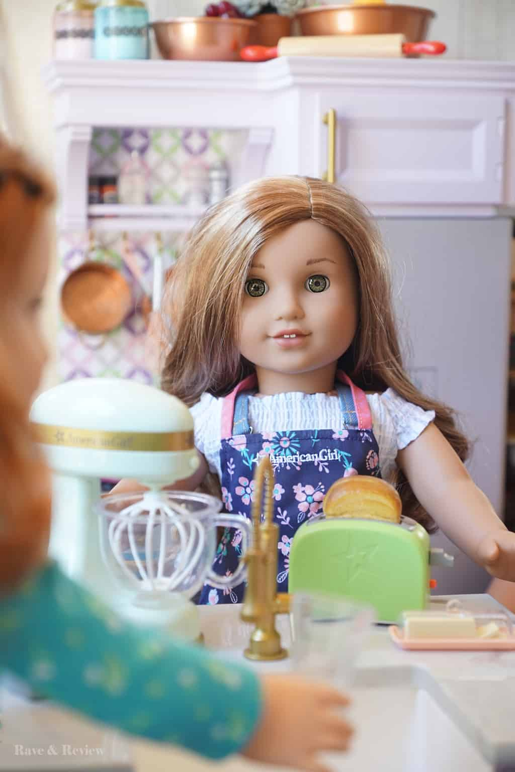 American Girl dolls in the kitchen